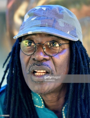 Ivorian reggae Alpha Blondy speaks during an interview at his radio station Alpha Blondy FM in Abidjan on March 17, 2015. AFP PHOTO/ SIA KAMBOU (Photo credit should read SIA KAMBOU/AFP/Getty Images)